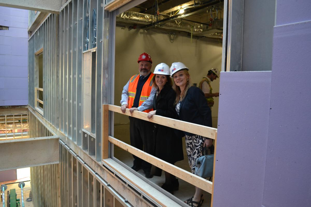 The Building Committee conducts a site visit on the Middle-High School in October 2019, admiring the construction progress.