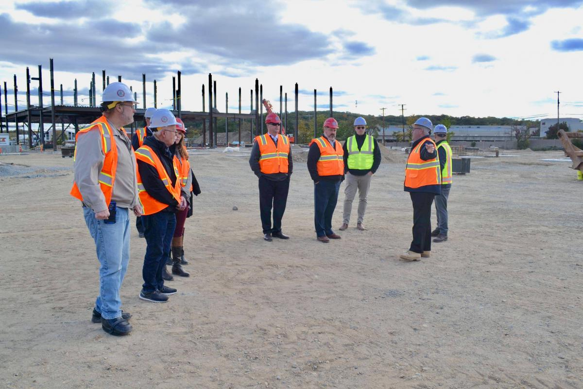 Members of the Building Committee take a site visit of construction on the new Middle-High School